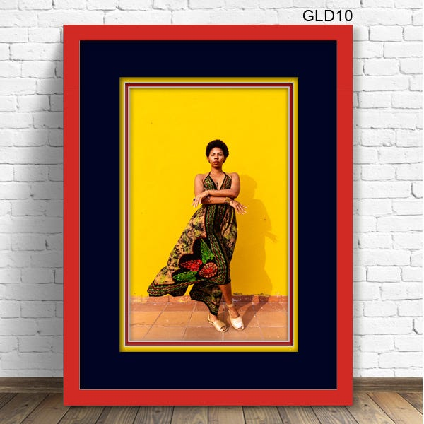 GLD10 Red picture frame with triple mats navy, yellow and red and woman in dress posing against yellow wall