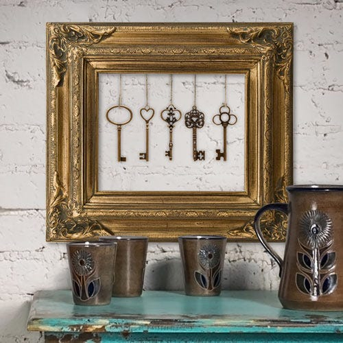 Gold frame with keys hanging inside