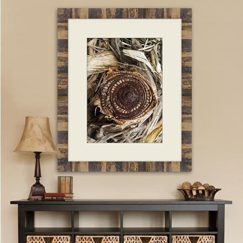 ELL2 framed print over console table.