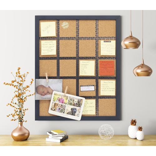 Framed cork board in modern office space.