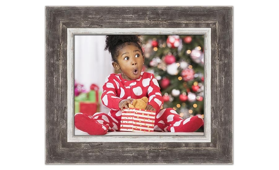 Little Girl Opening a Present in a Barnwood Frame