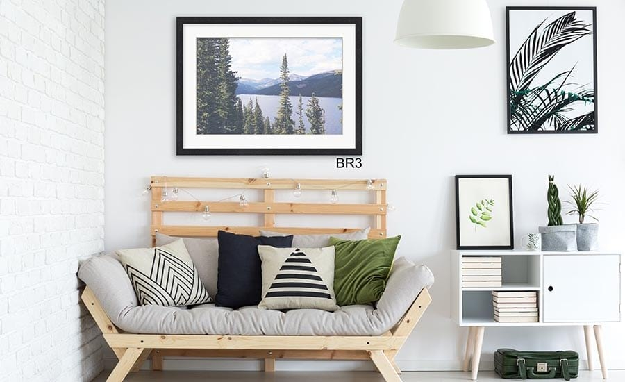 Mountainscape Photo with White Mat and Black Frame in Modern Sitting Room
