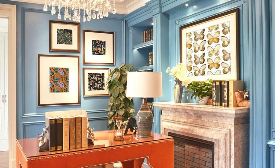 Art in Custom Wood Frames with Mats on Blue Wall