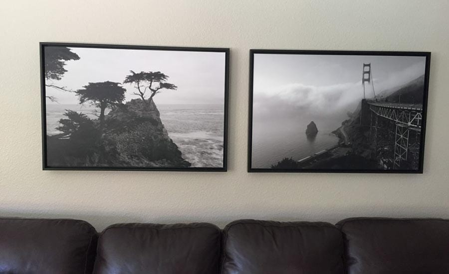 Coastal Photo Custom Framed in Black Wood Frames Above Couch