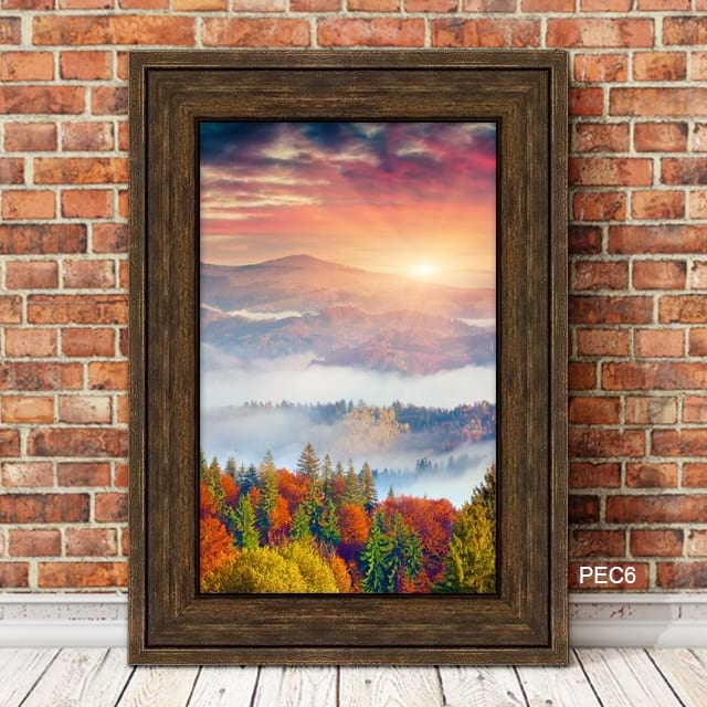 Sunset over Mountains Framed in Brown Expresso Wood Frame