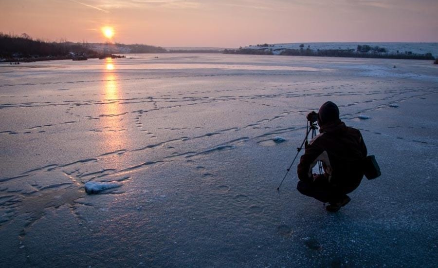 Pro Photographer Taking Picture at Beach Sunset