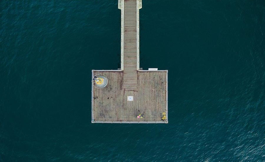 Drone Photography of Dock on Ocean