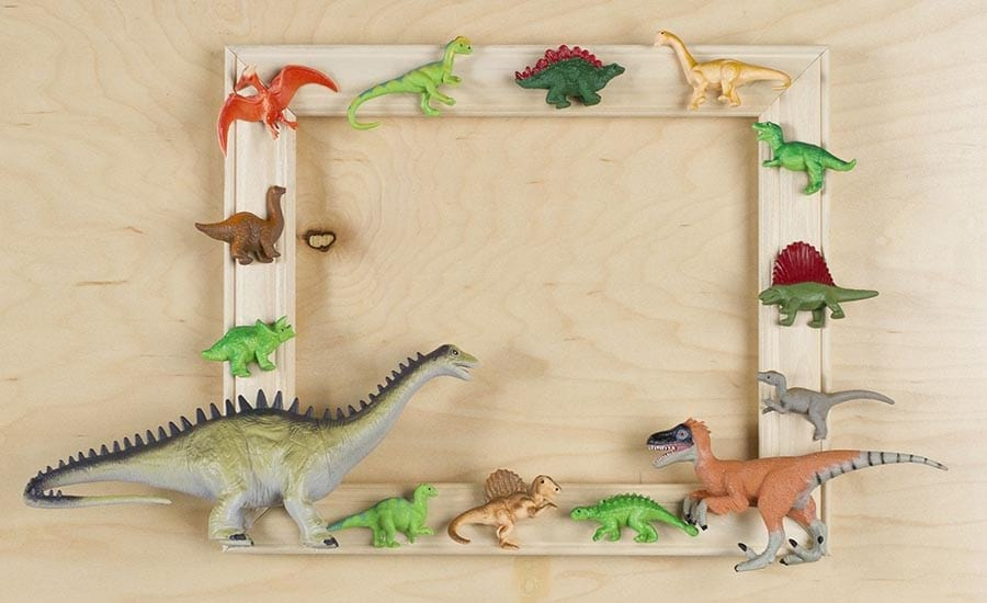 Toy Dinosaurs on Unfinished Picture Frame