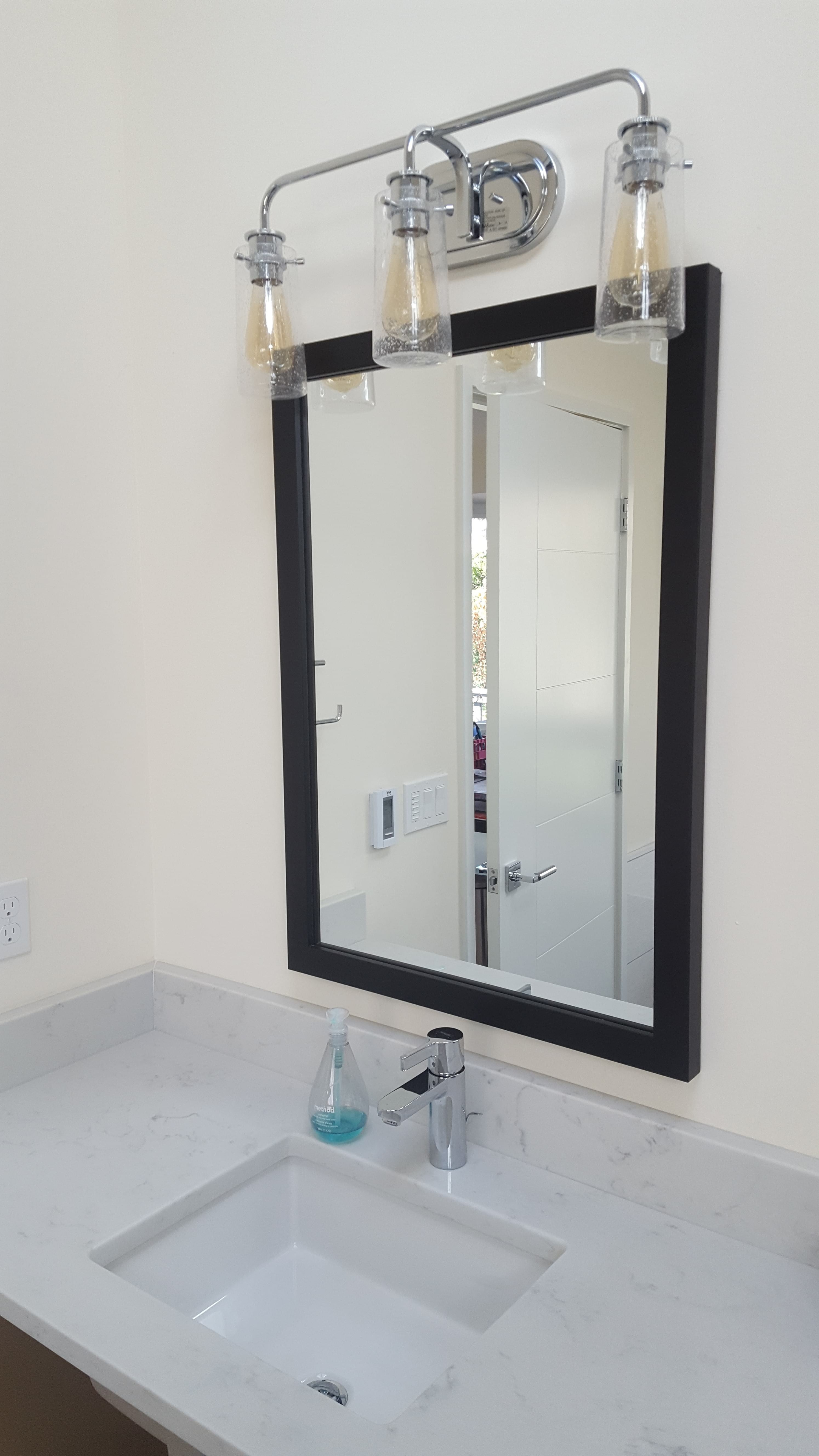 Custom Framed Mirror in Black Frame in Bathroom