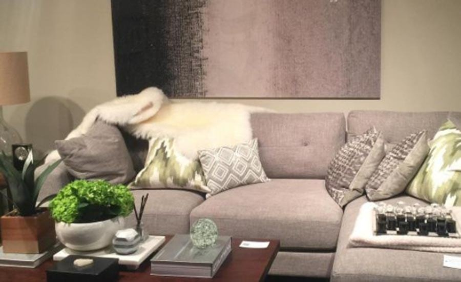 Gray furniture and art accenting a space captured by designer Keffie Lancaster