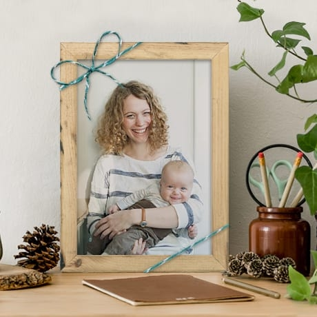 a photo of a baby in a frame from Framebridge